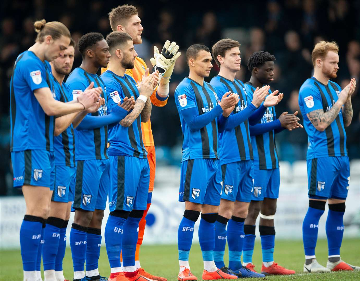 The Gills players pay their respects to England legend Gordon Banks with a minute's applause Picture: Ady Kerry