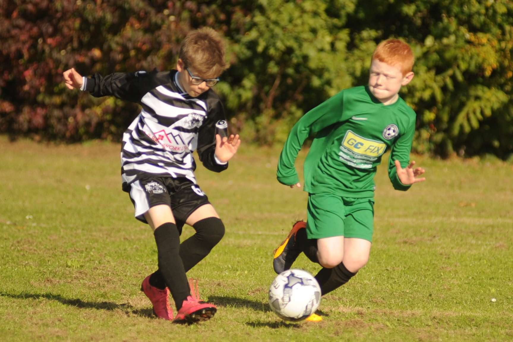 Milton & Fulston United under-10s in possession against New Ash Green Picture: Steve Crispe