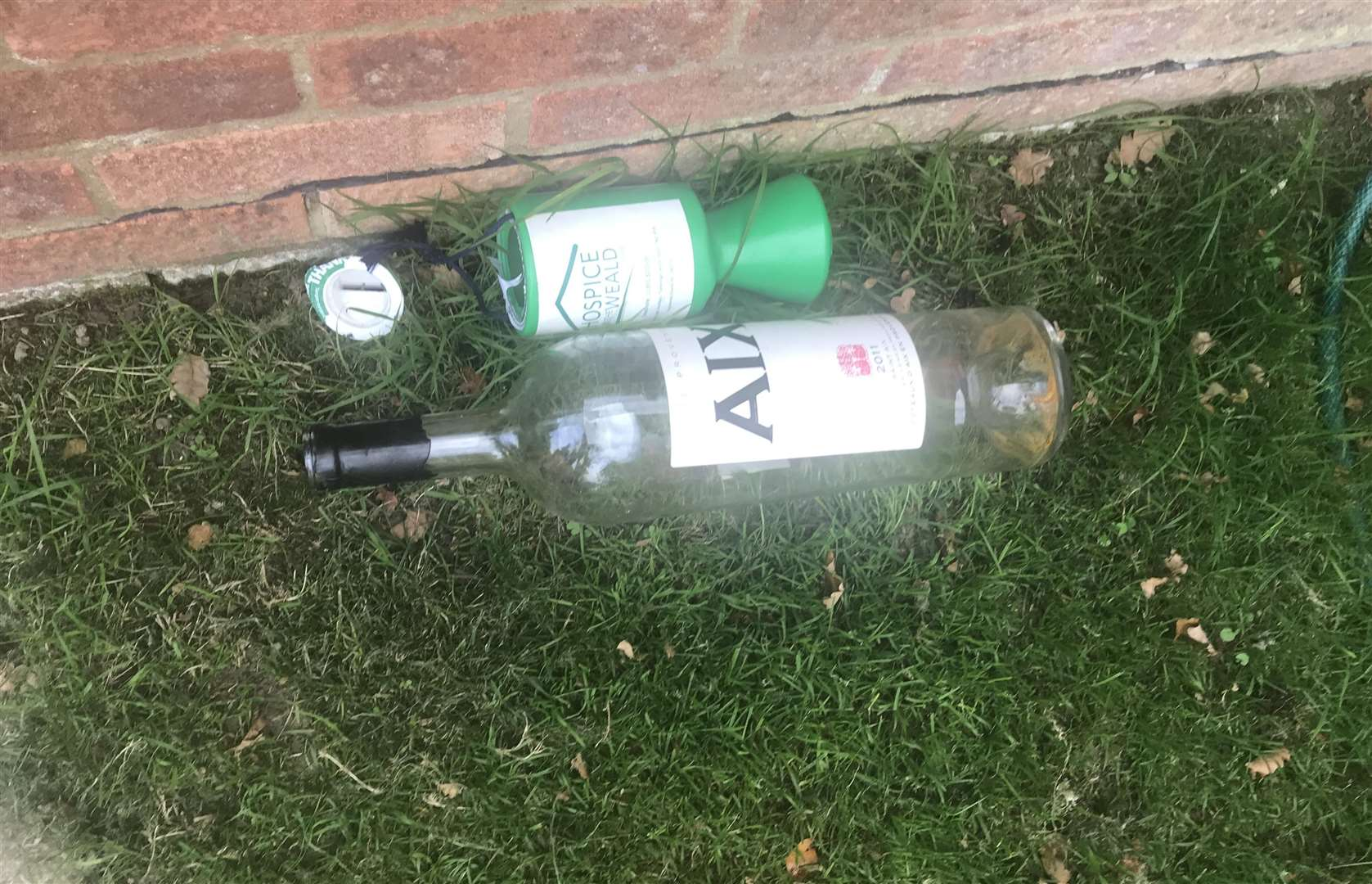The discarded Hospice in the Weald tin and captain's bottle