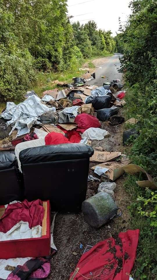 A black leath sofa and multiple rubbish bags were dumped in Downs Road, near Gravesend Picture: Richard Rushen (13716209)