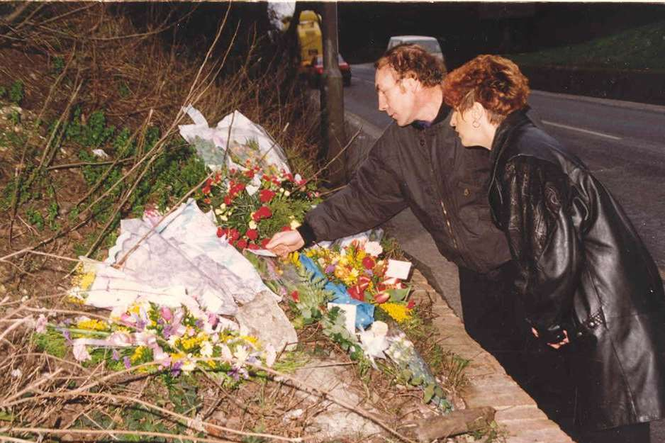 Claire's parents Cliff and Linda lay flowers at the spot where she died