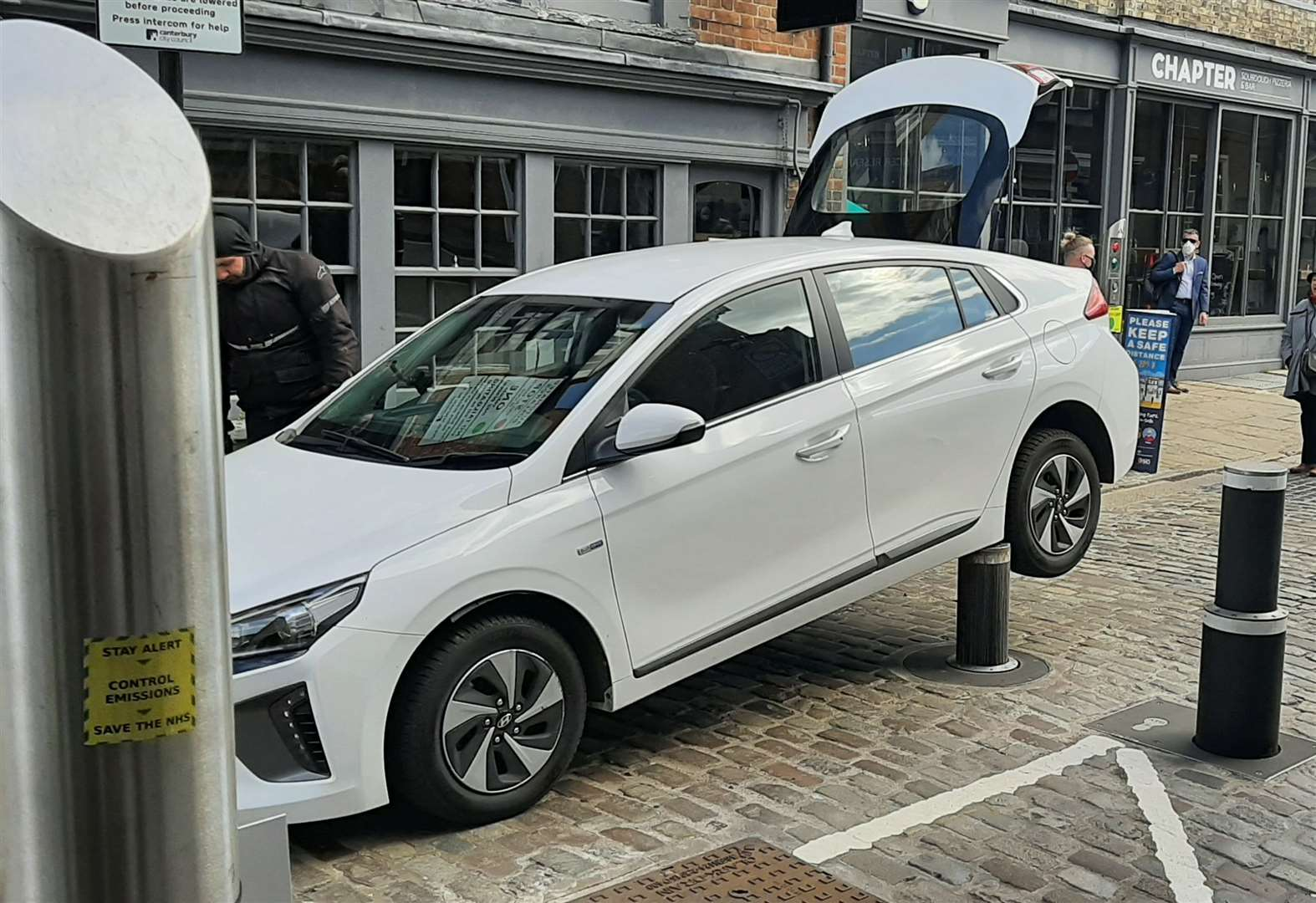 Oh dear! Driver gets car trapped on anti-terror bollard