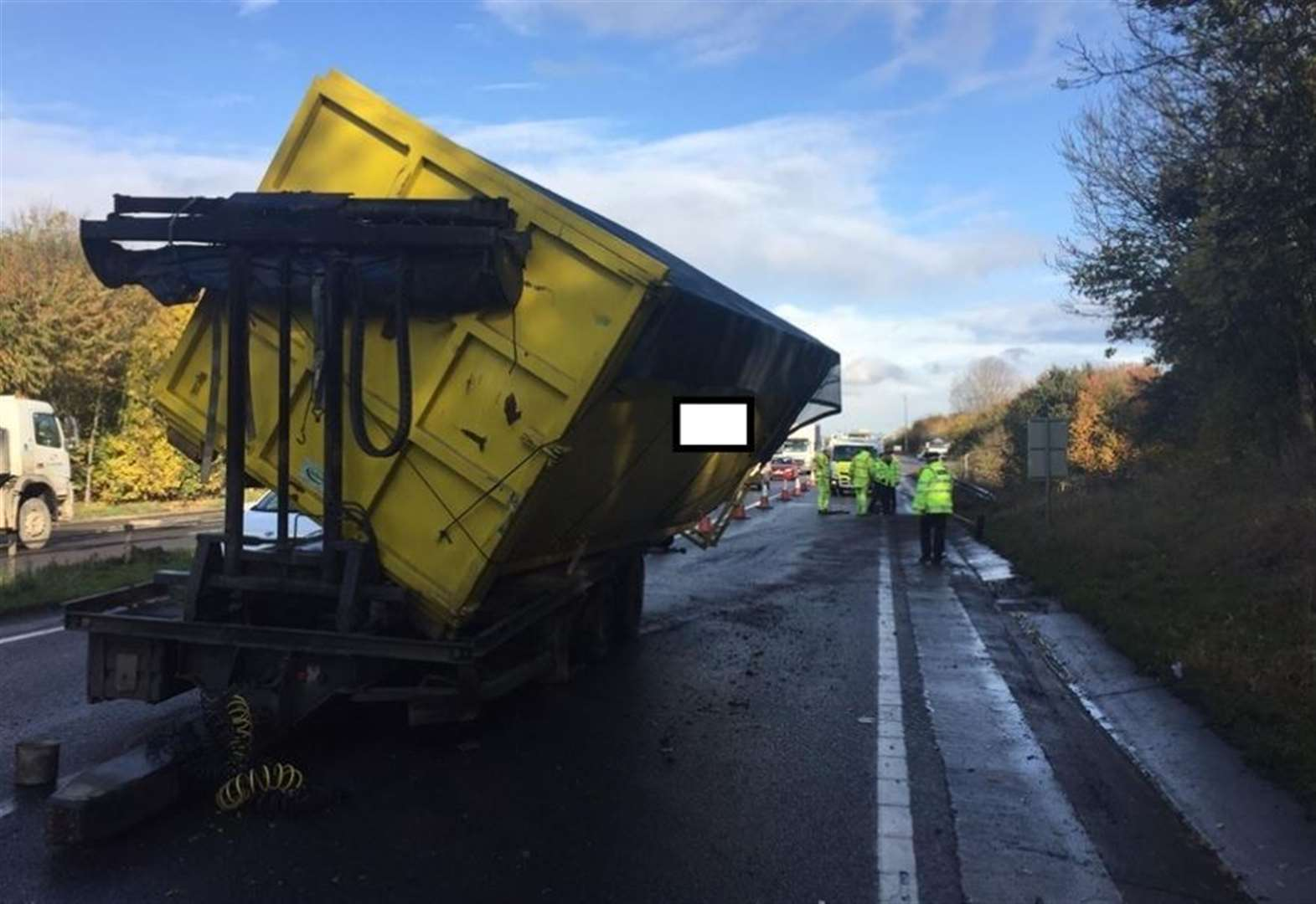 Delays as lorry sheds its load