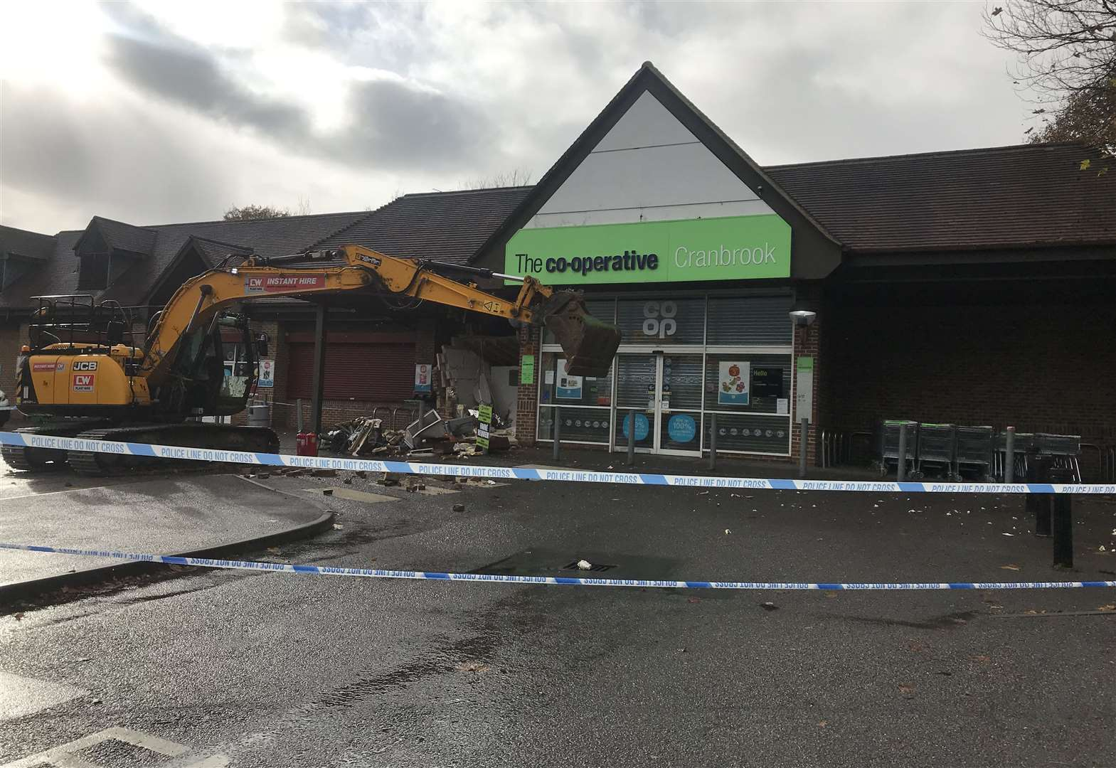 Store smashed by digger reopens
