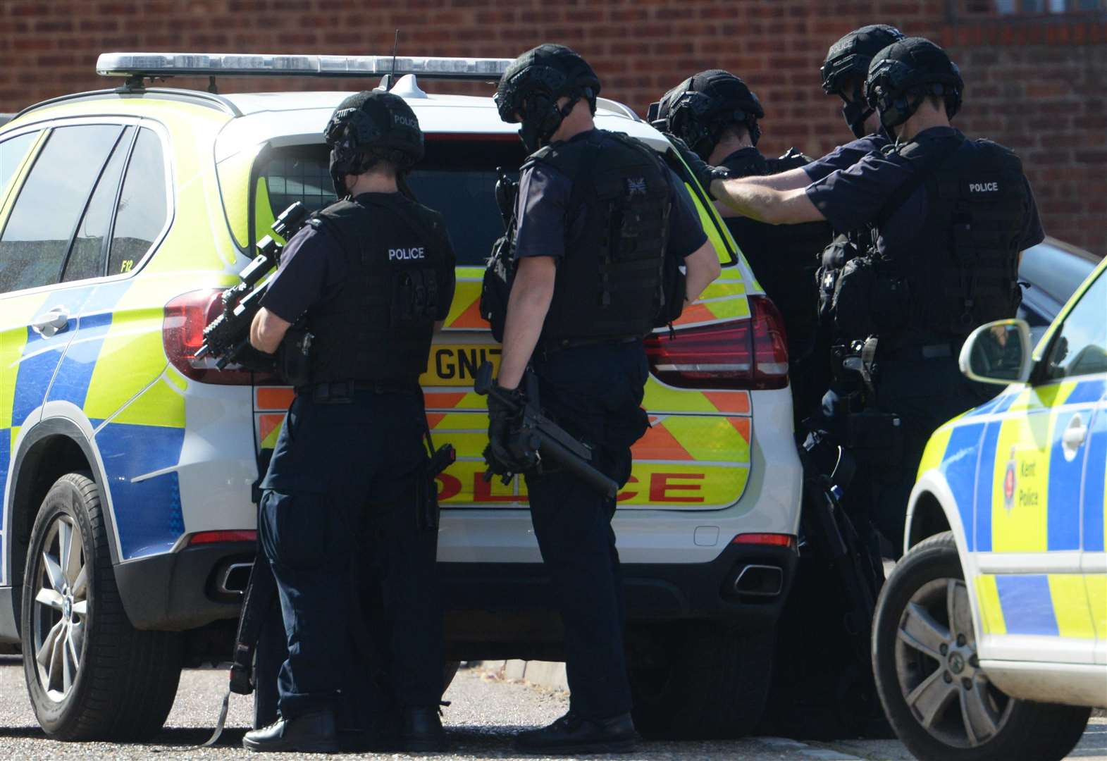 Armed officers swoop on village