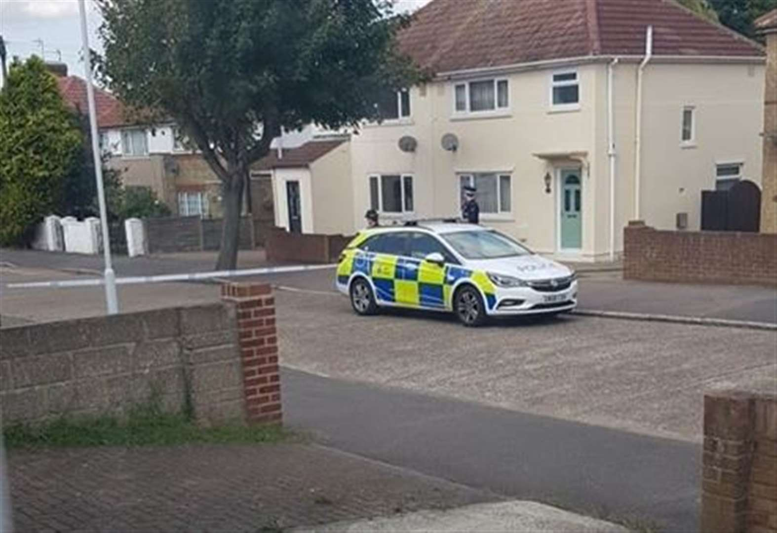 Armed police close road