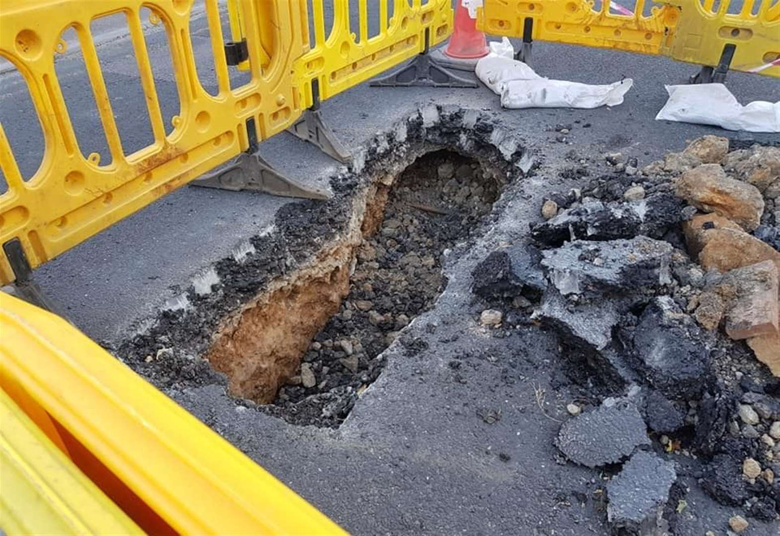 Road closed as sinkhole emerges