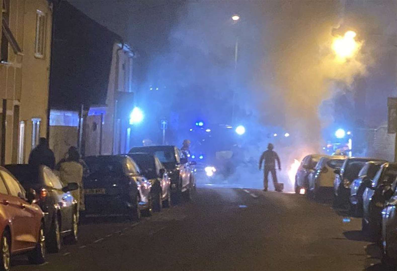 Vehicles torched in nearby streets