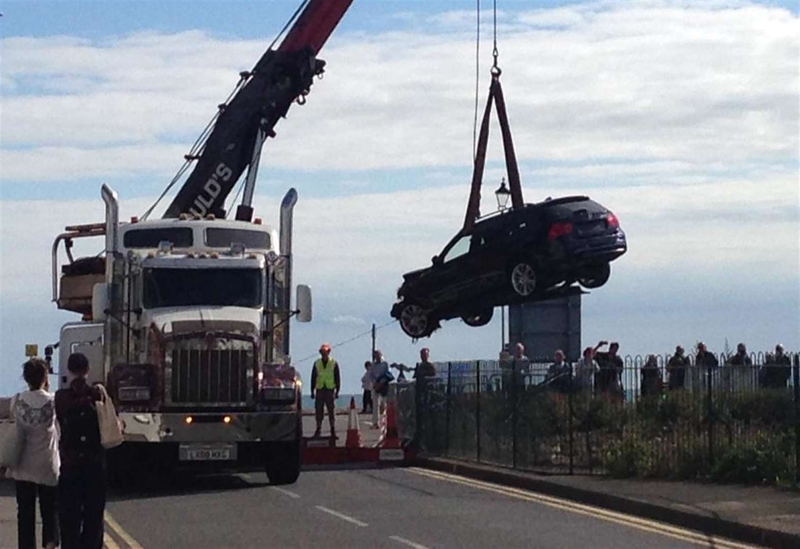 Crane removes car from castle moat