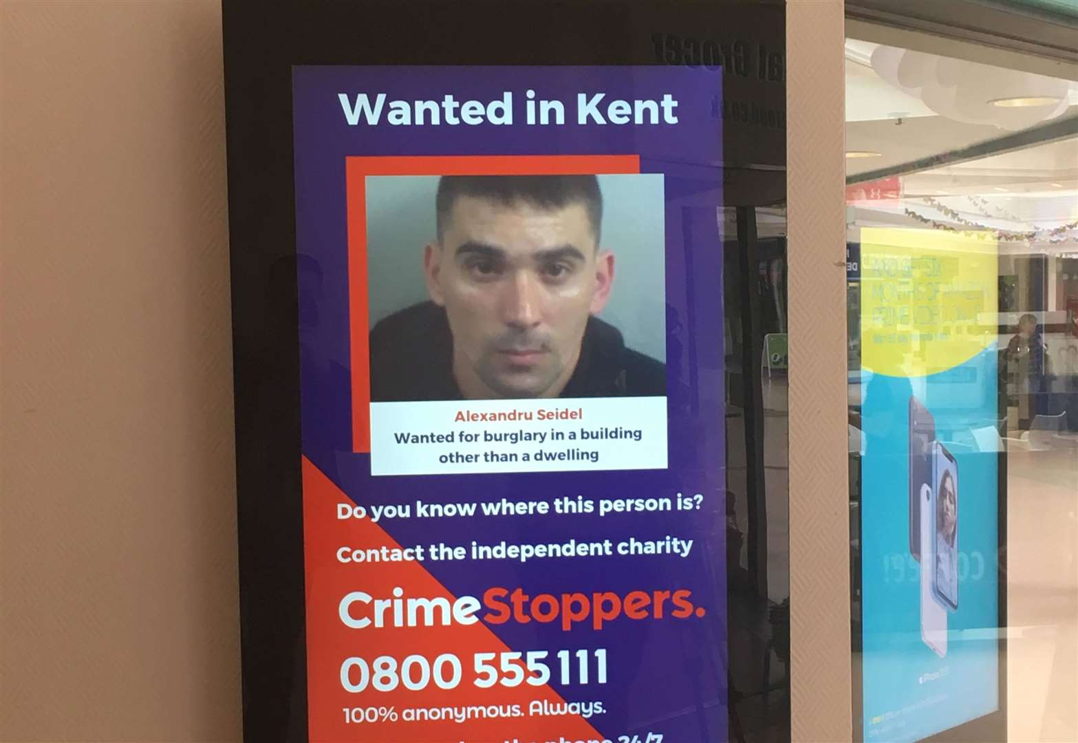 Images of suspects on display in town centre