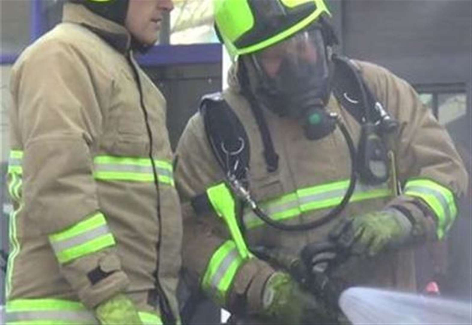 Woman treated for smoke inhalation after iron sparks blaze