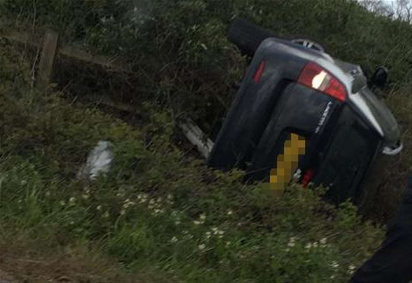 Delays on M2 as car overturns
