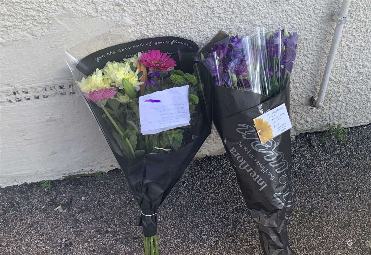 Tributes left to woman found dead