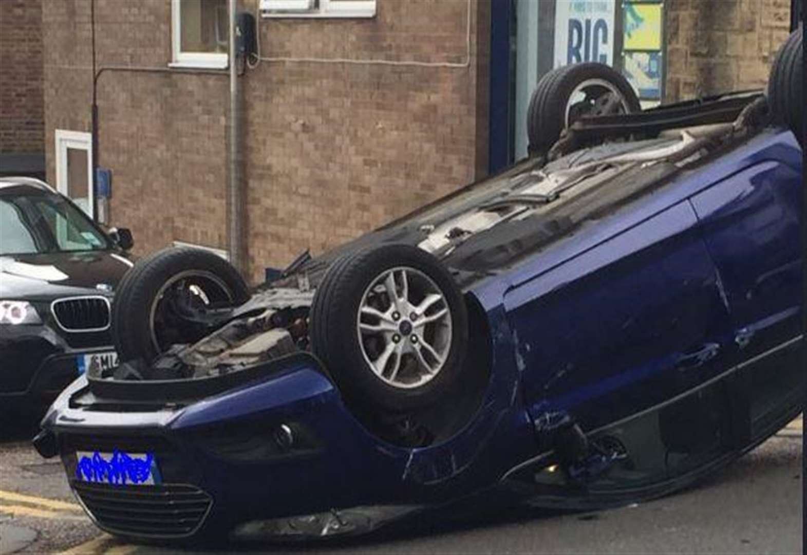 Car overturns in town centre