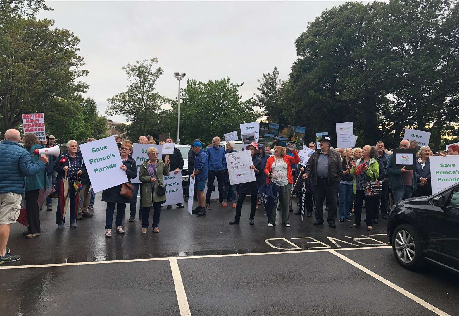 Almost 200 protestors march on council