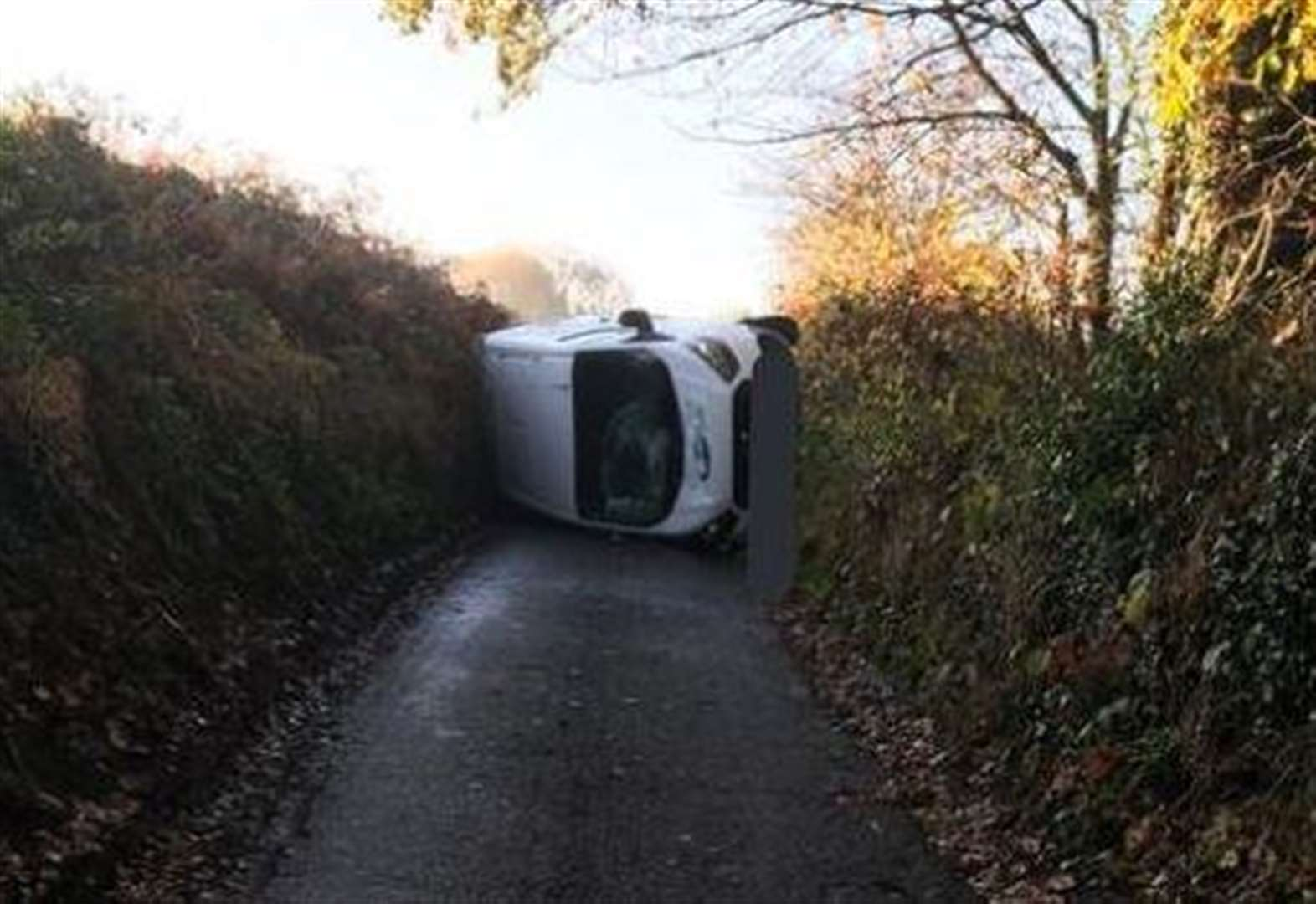 Van flips in crash on country road