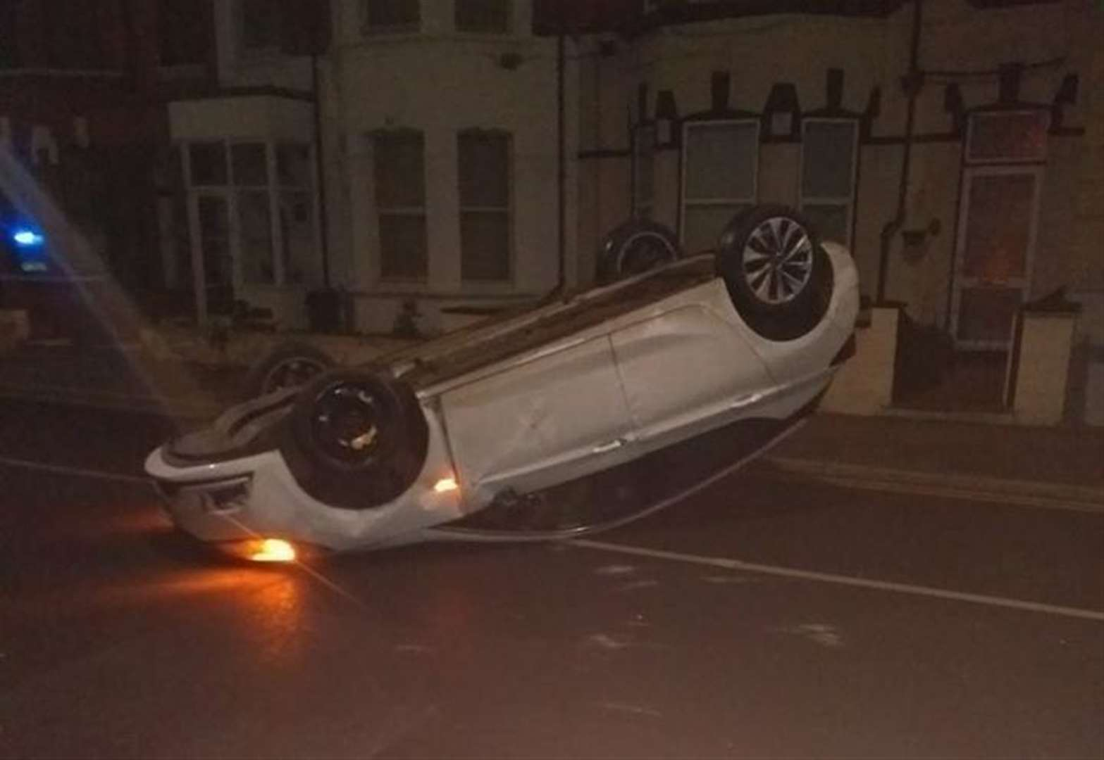 Person in hospital after car flips