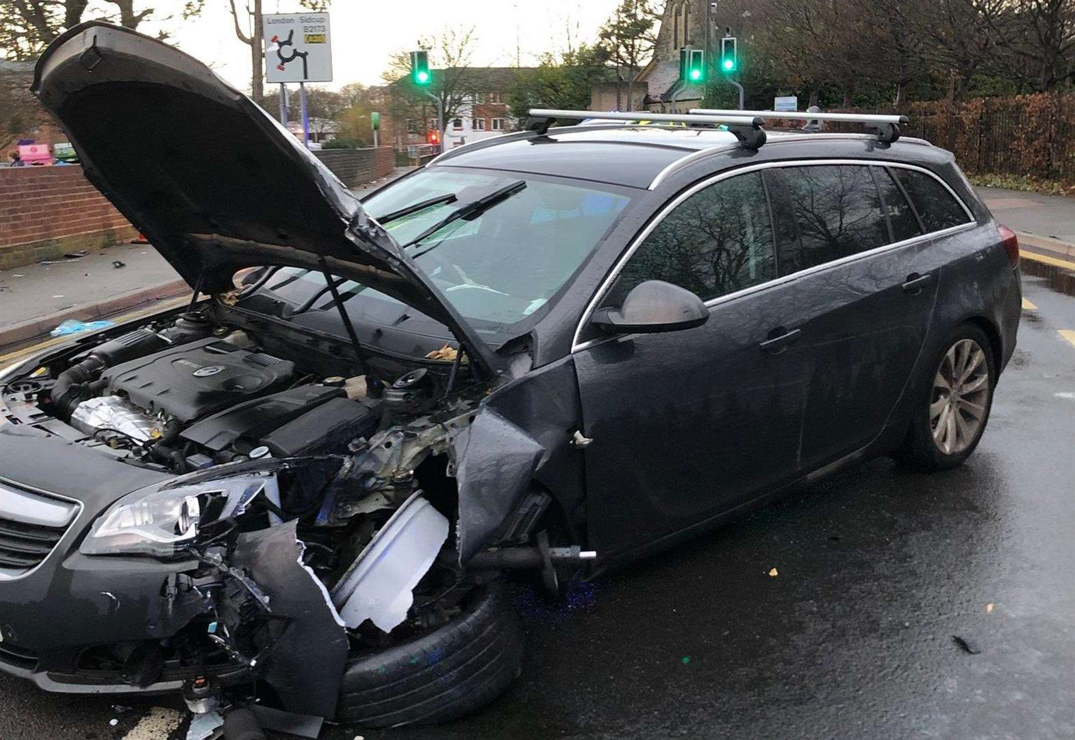 Road reopens after car hits lamppost