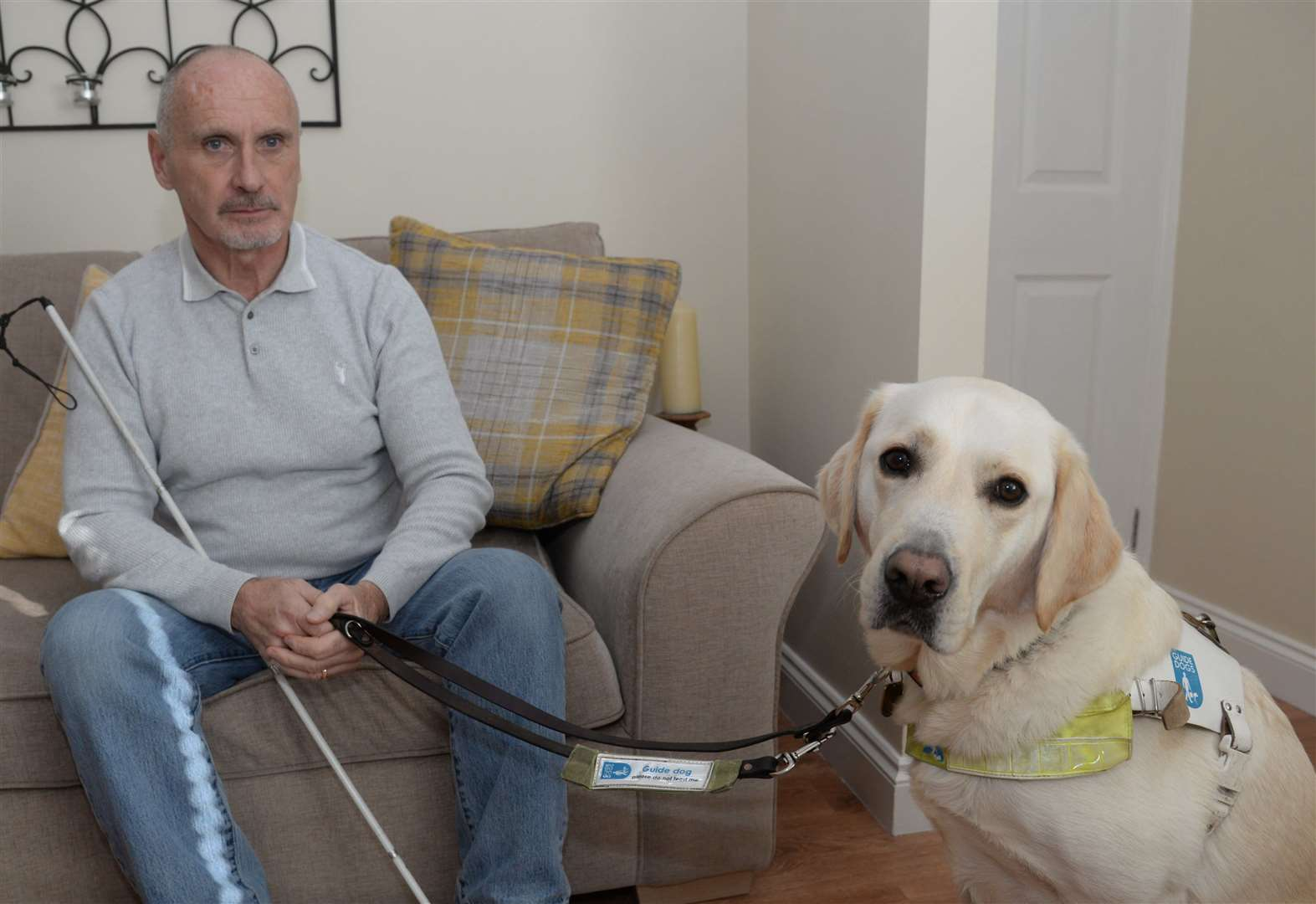 Blind man clings desperately to guide dog during attack