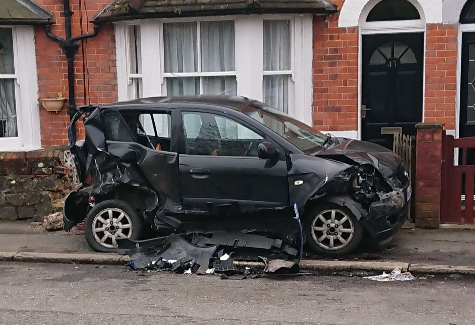 Car abandoned after smashing into wall