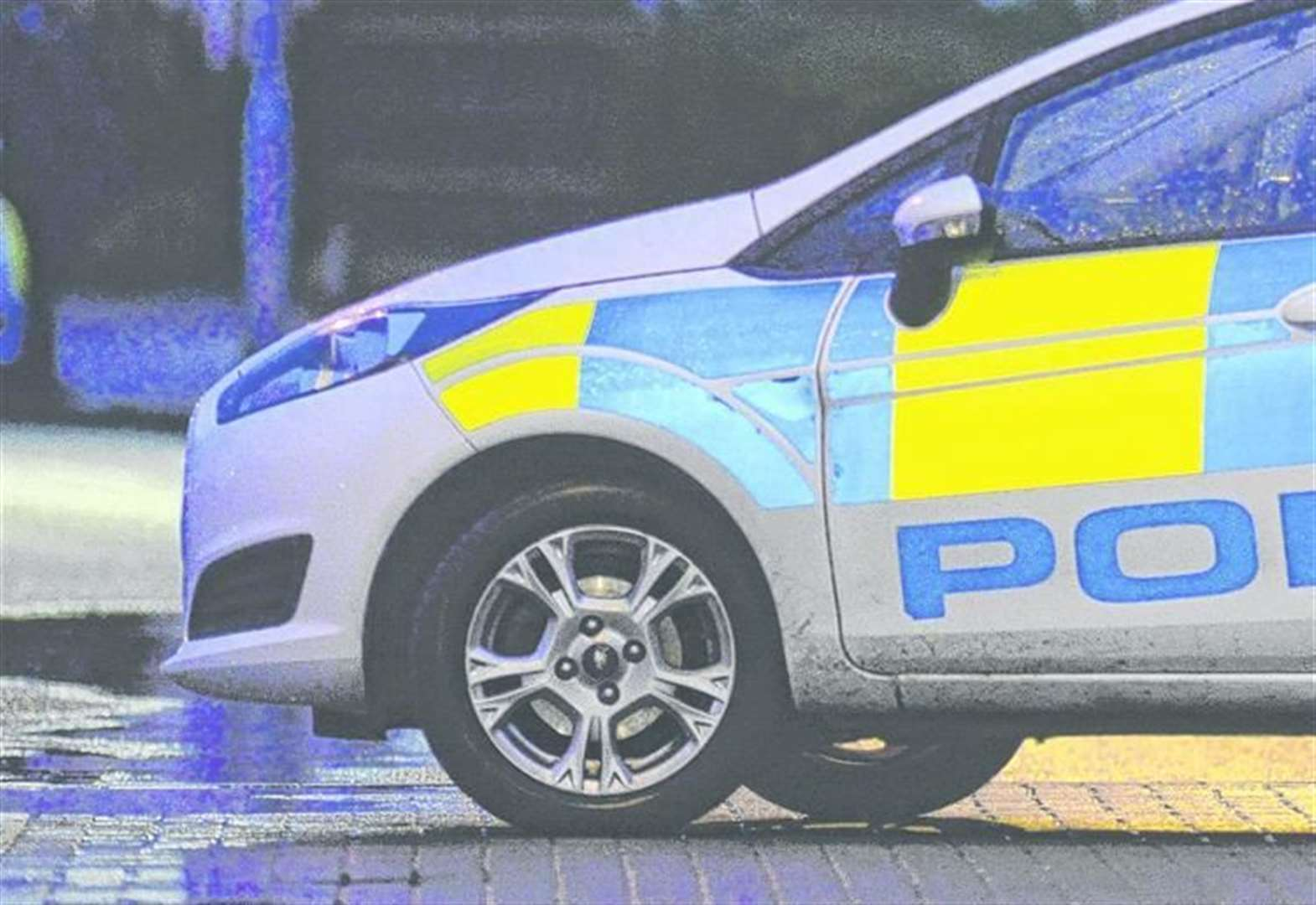 Road closed after man 'spotted with weapon'