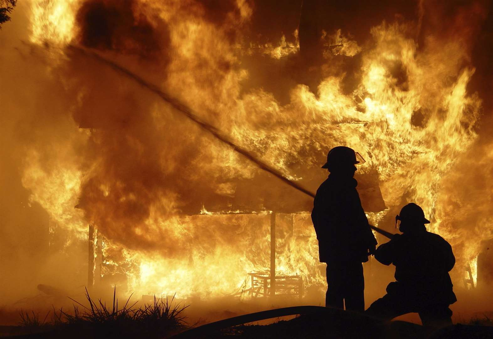 Crews tackle barn blaze through night