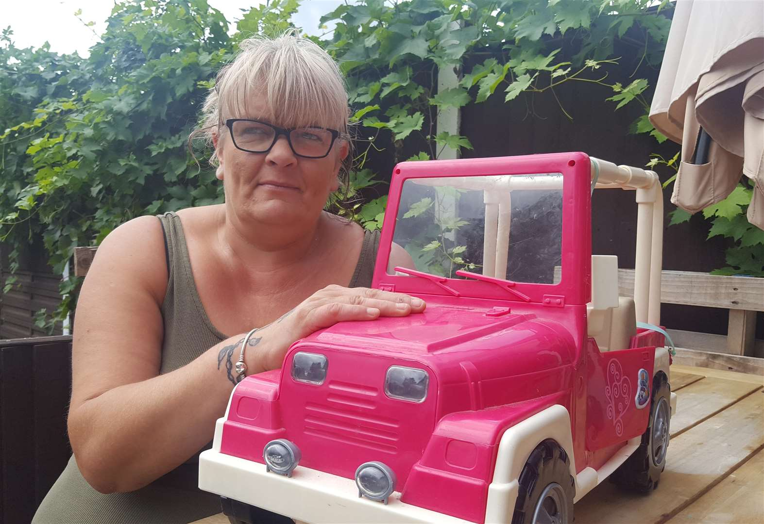 Mum fights off home intruders with toy car