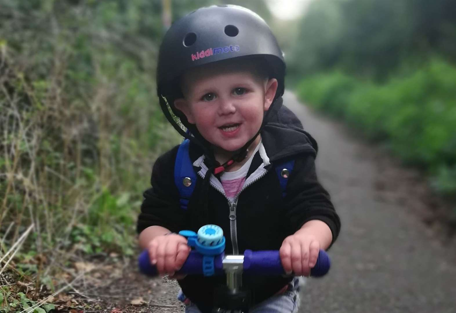 Two-year-old hit by overtaking car suffers head injury