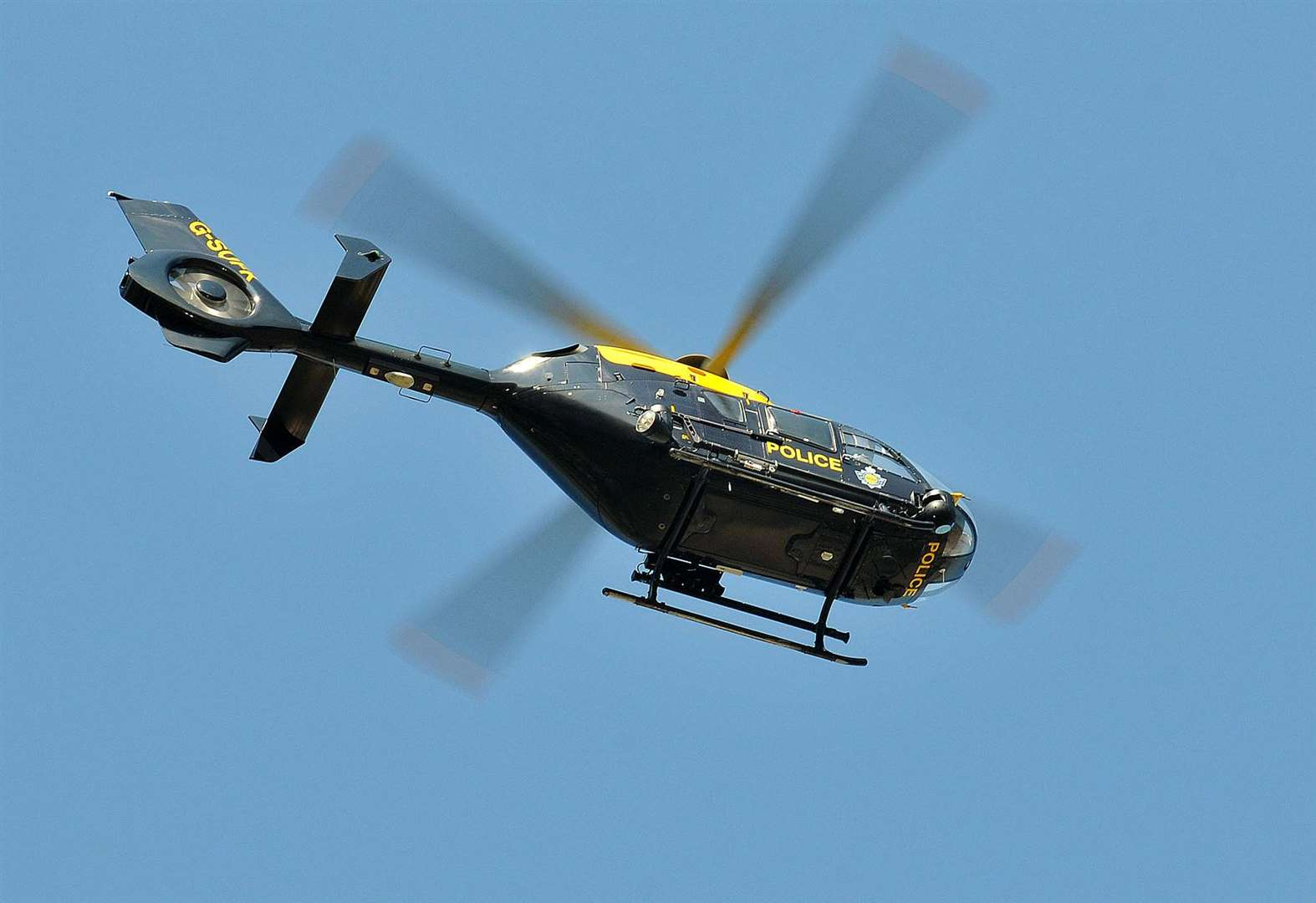 Helicopter searches for runaway suspect