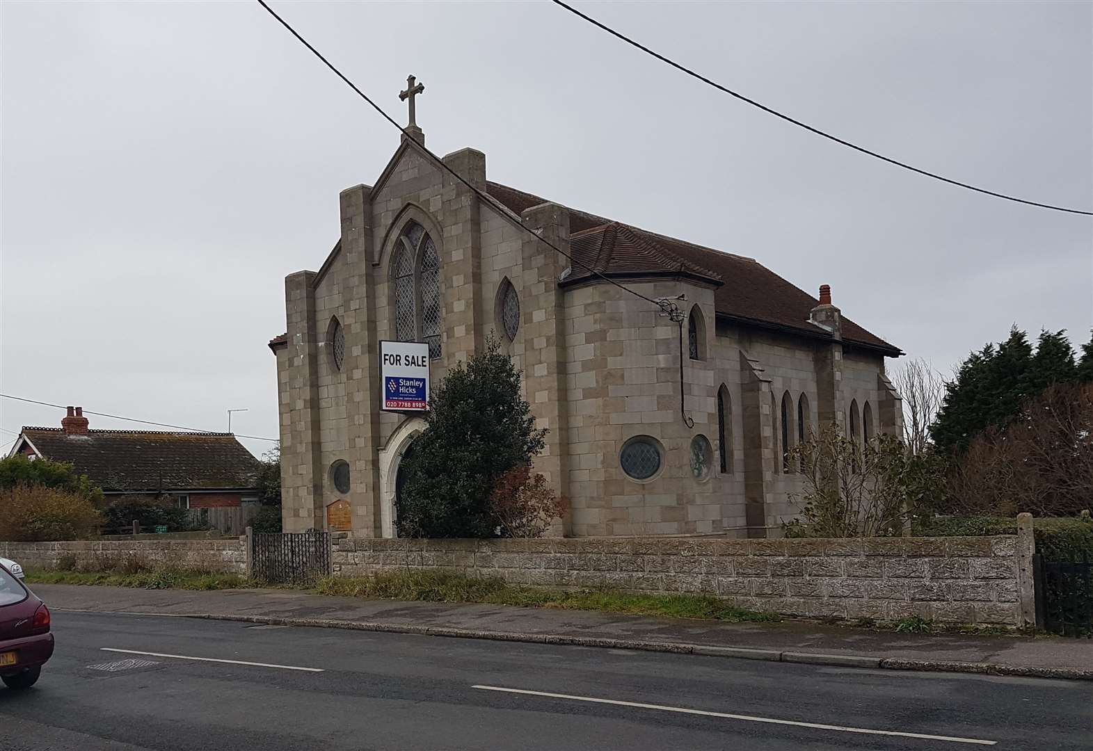 Houses destined for land at historic and derelict church