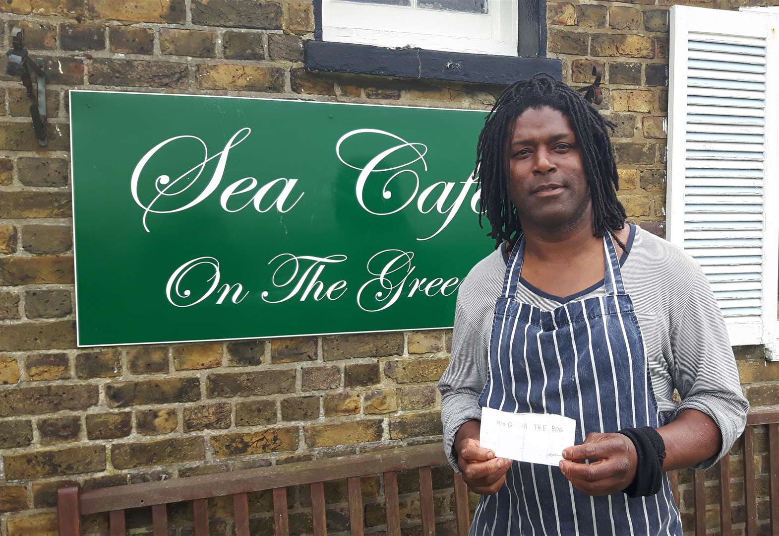 Café owner to frame and display racist note