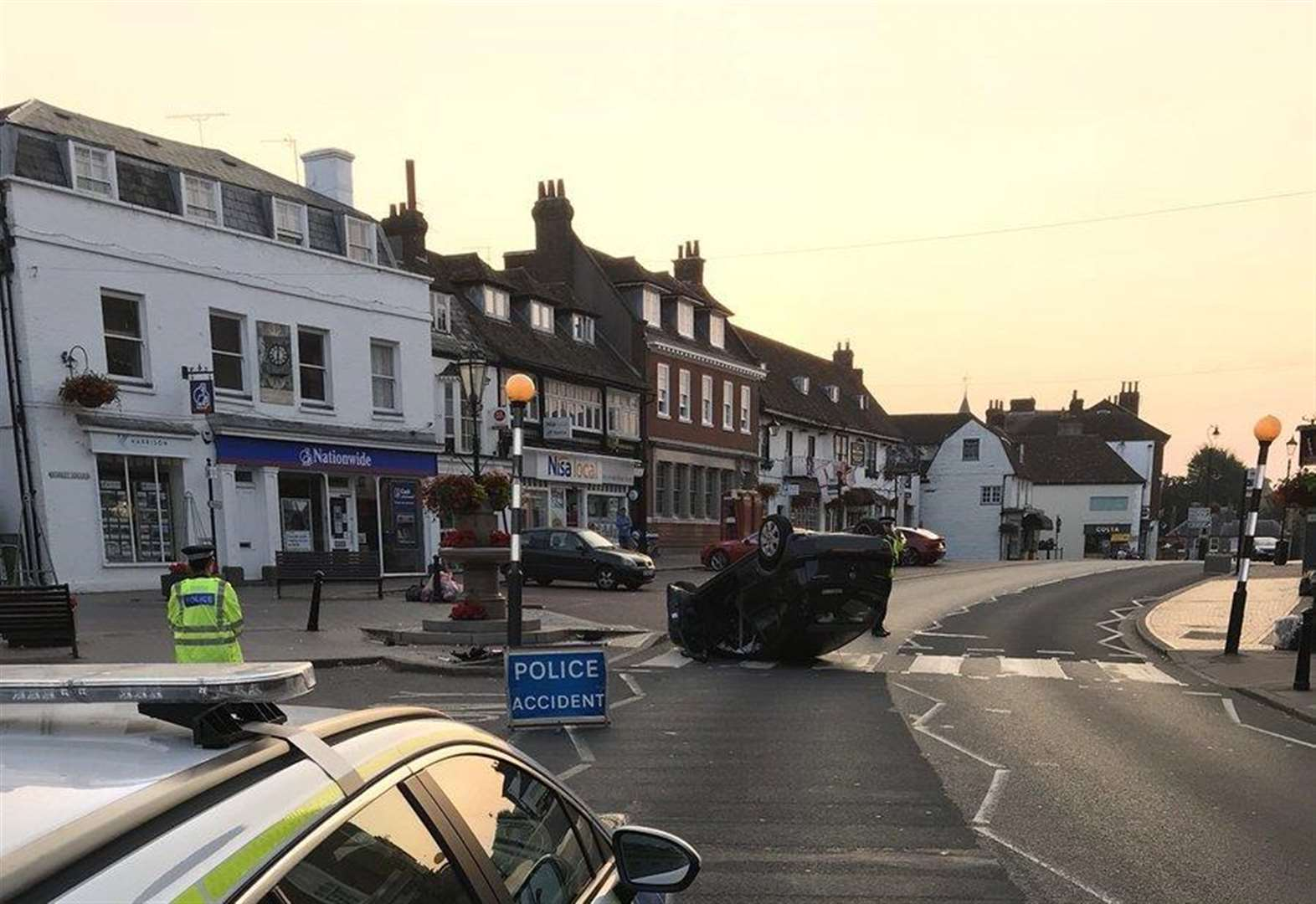Car flips onto its roof after crash