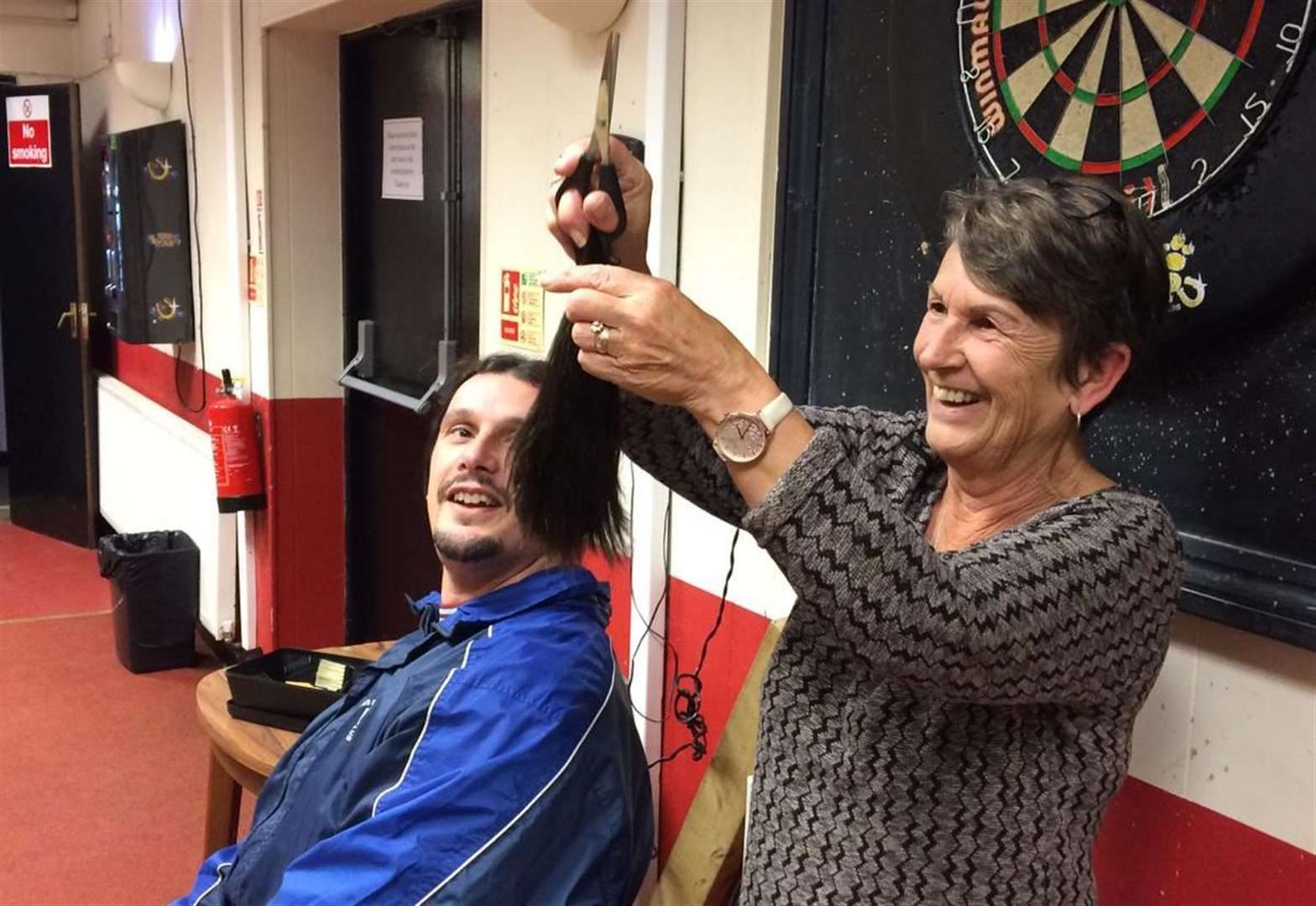 Father's head shave to repay medics