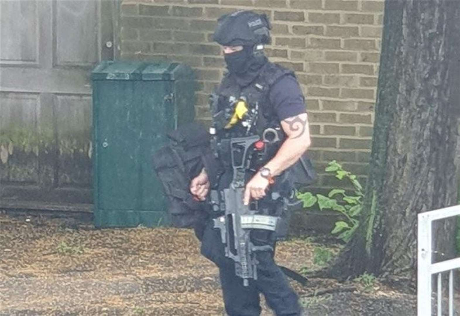 Armed police arrest man near primary school