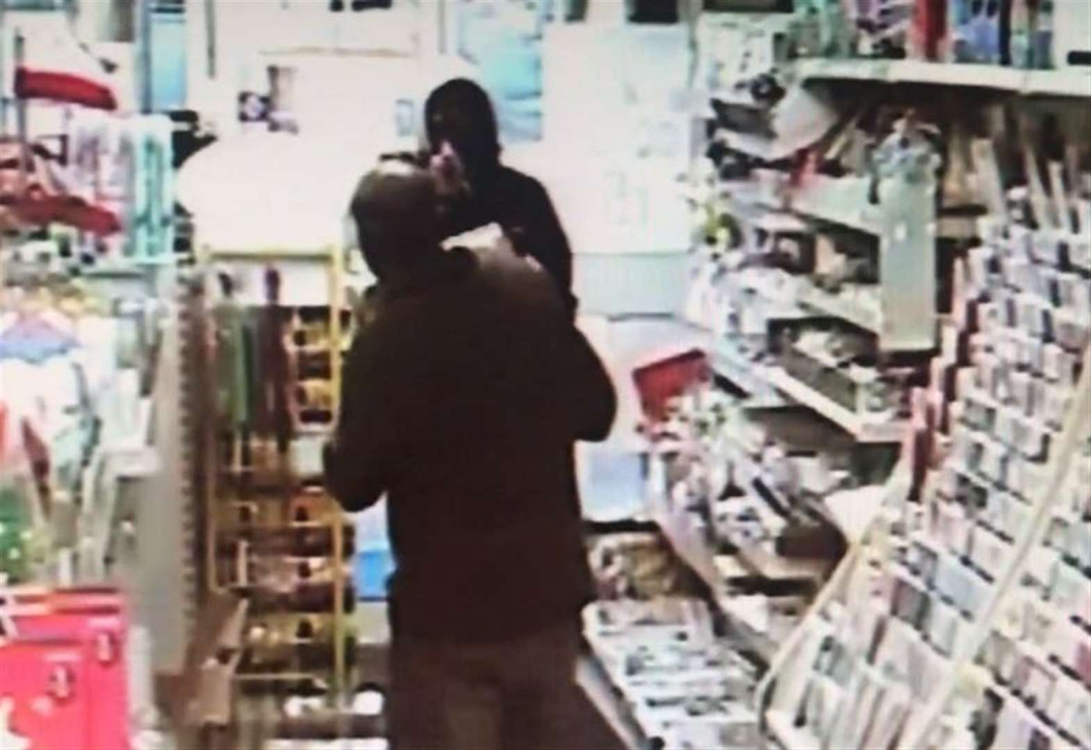 Exclusive: Video shows shopkeeper battle gunman in armed raid