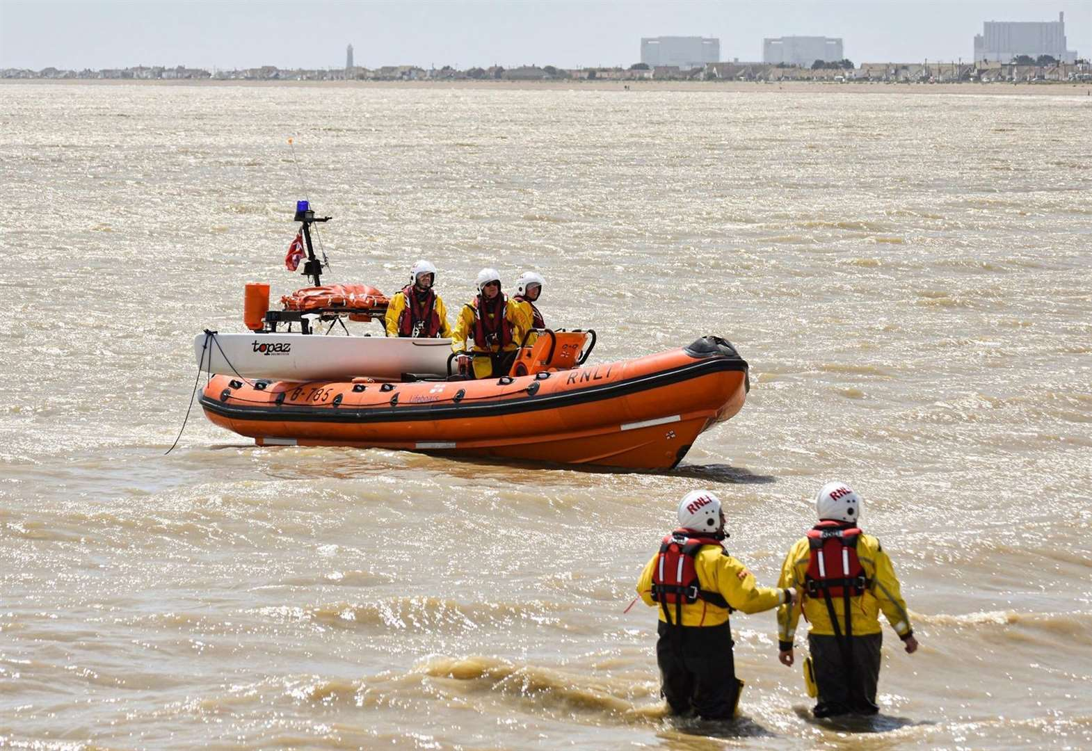 One man in hospital after dinghy capsizes