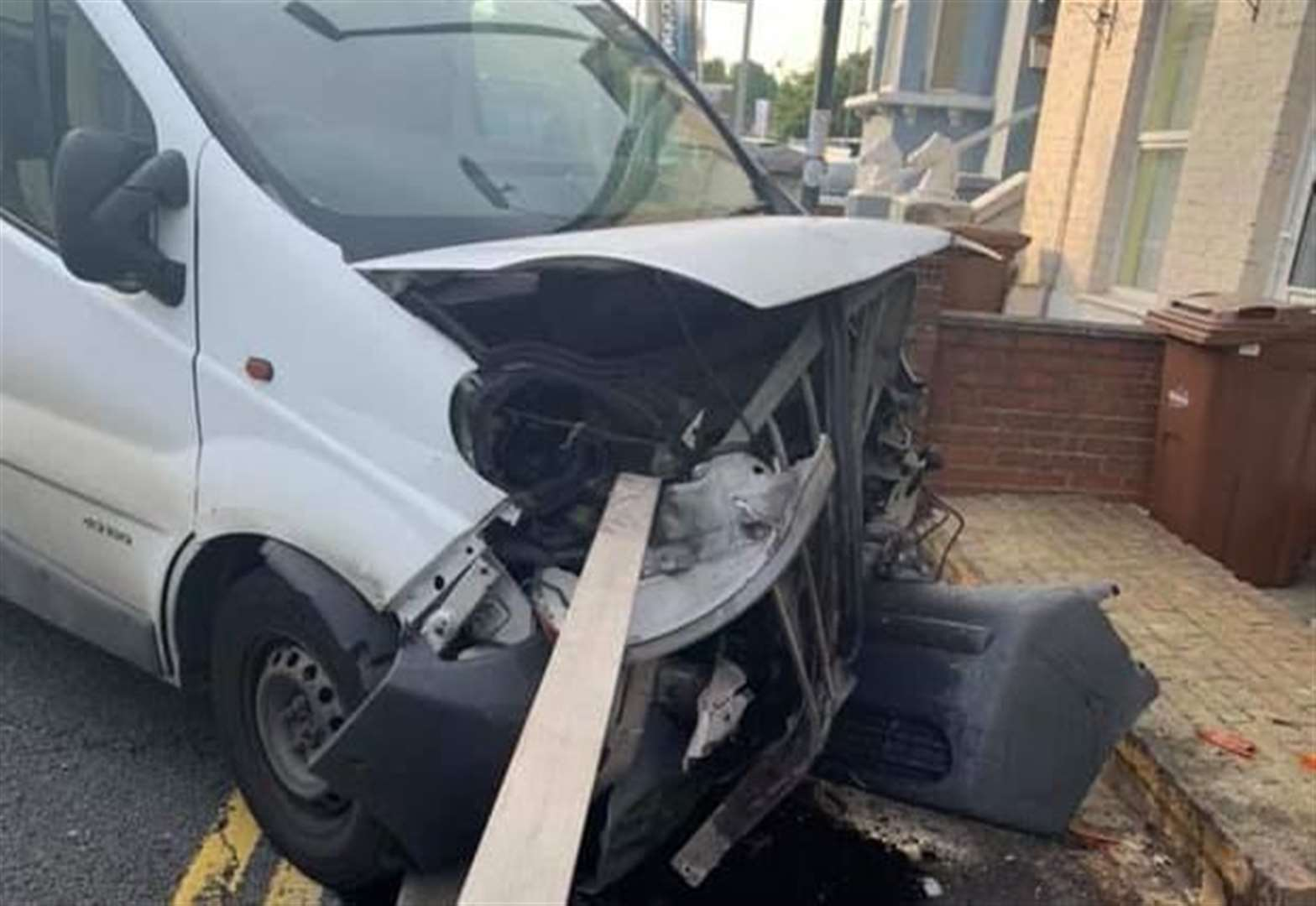 Van ruined after colliding with a fence