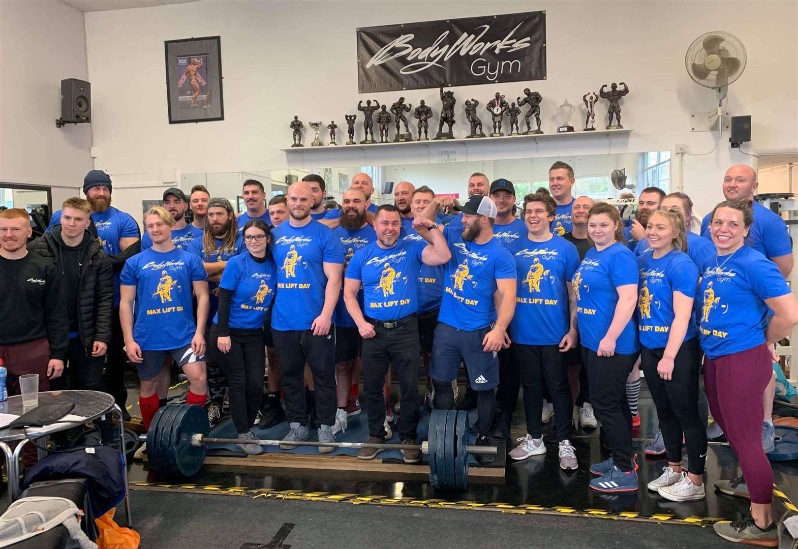 Powerlifting champs lift trophies