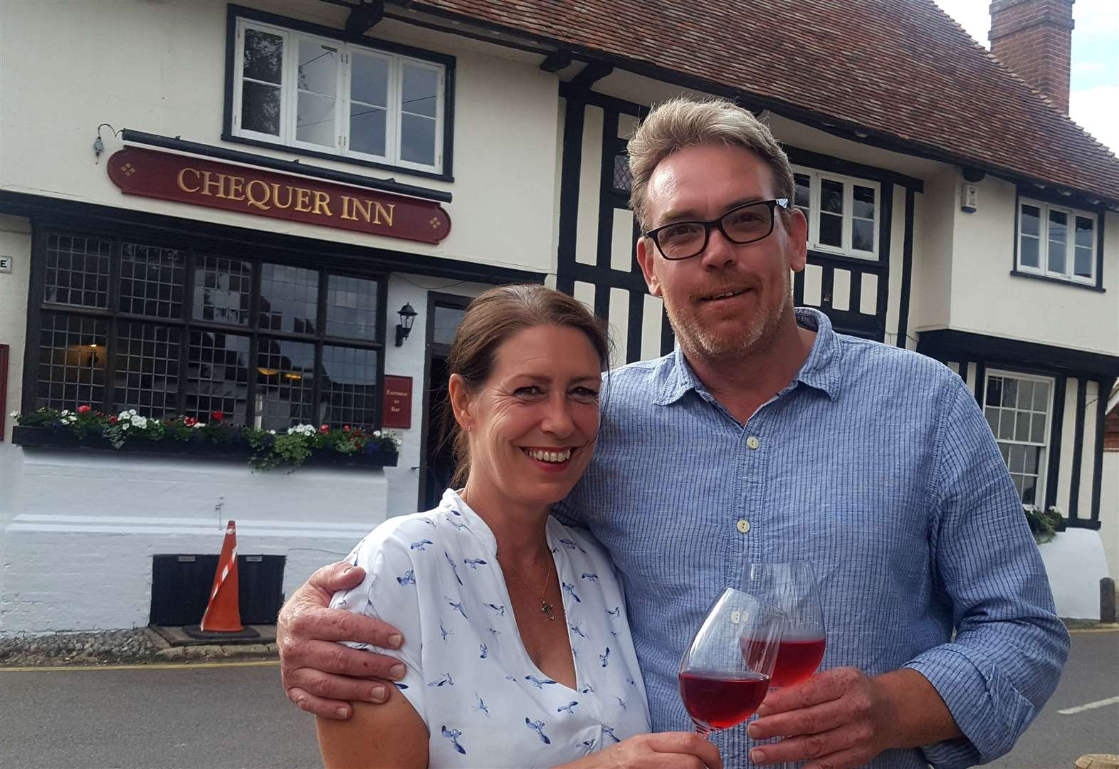 Raising a glass at re-opening after campaign