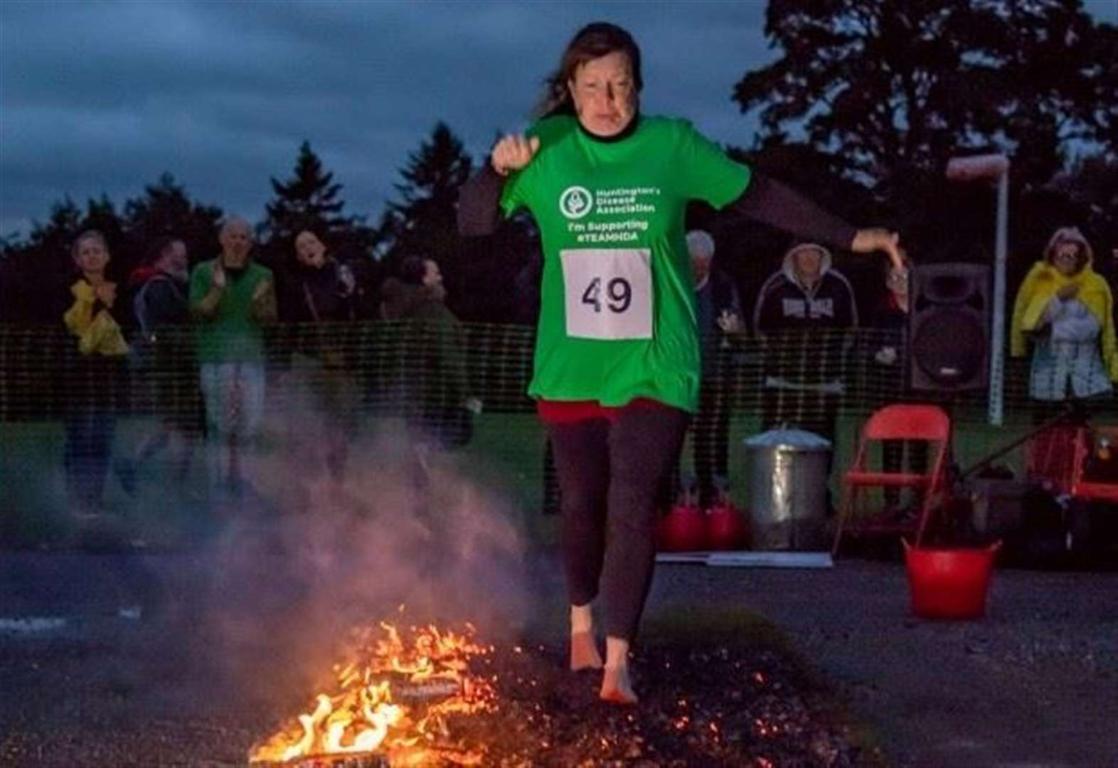 Firewalkers raise £14,000 for good causes