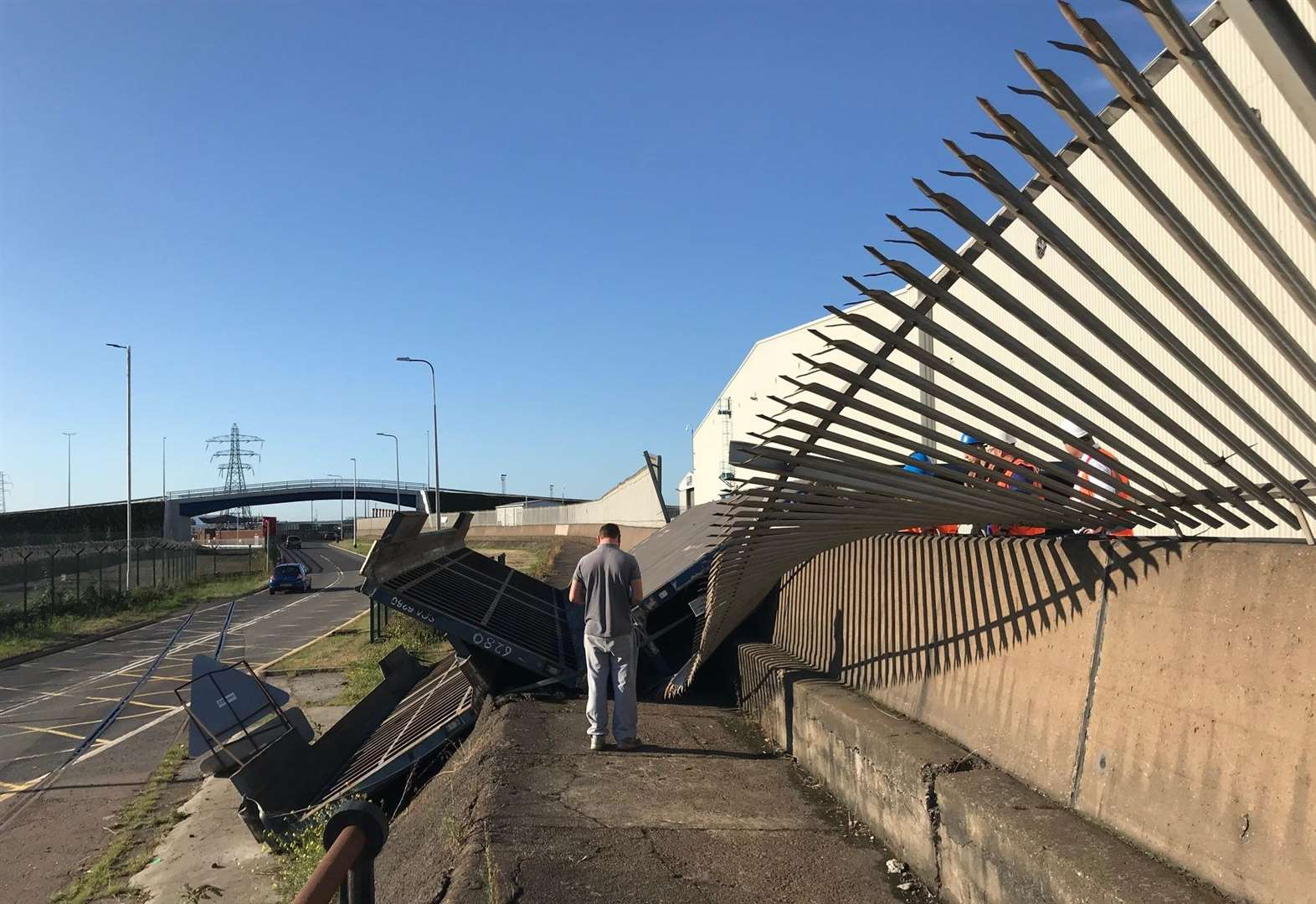 Trailer crushes security fence at port