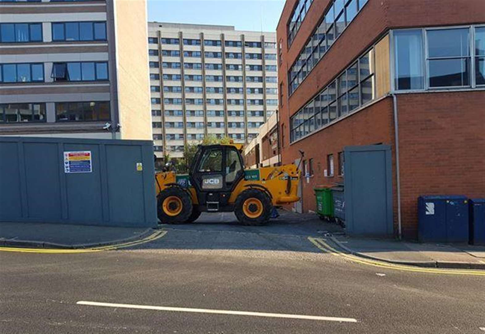 JCB blocks travellers from site