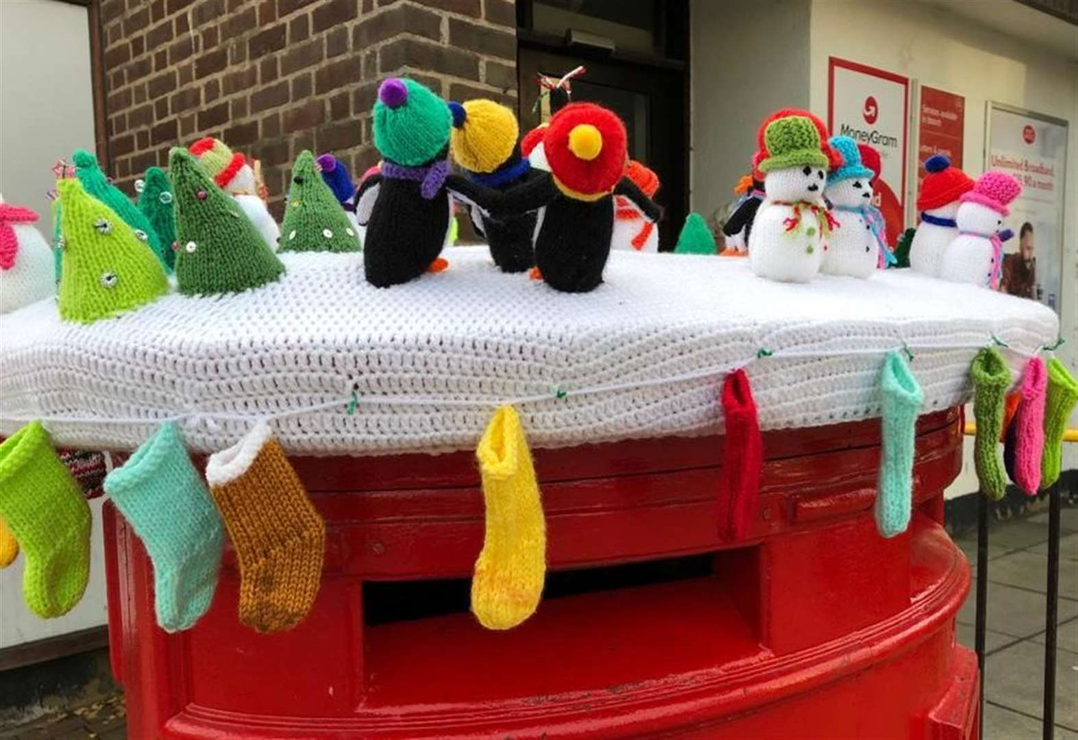 Knitters deliver festive cheer across town