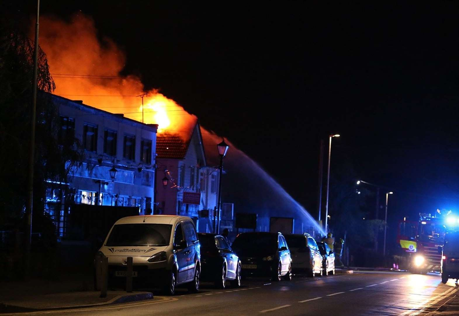 Dramatic pictures of curry house and flats fire