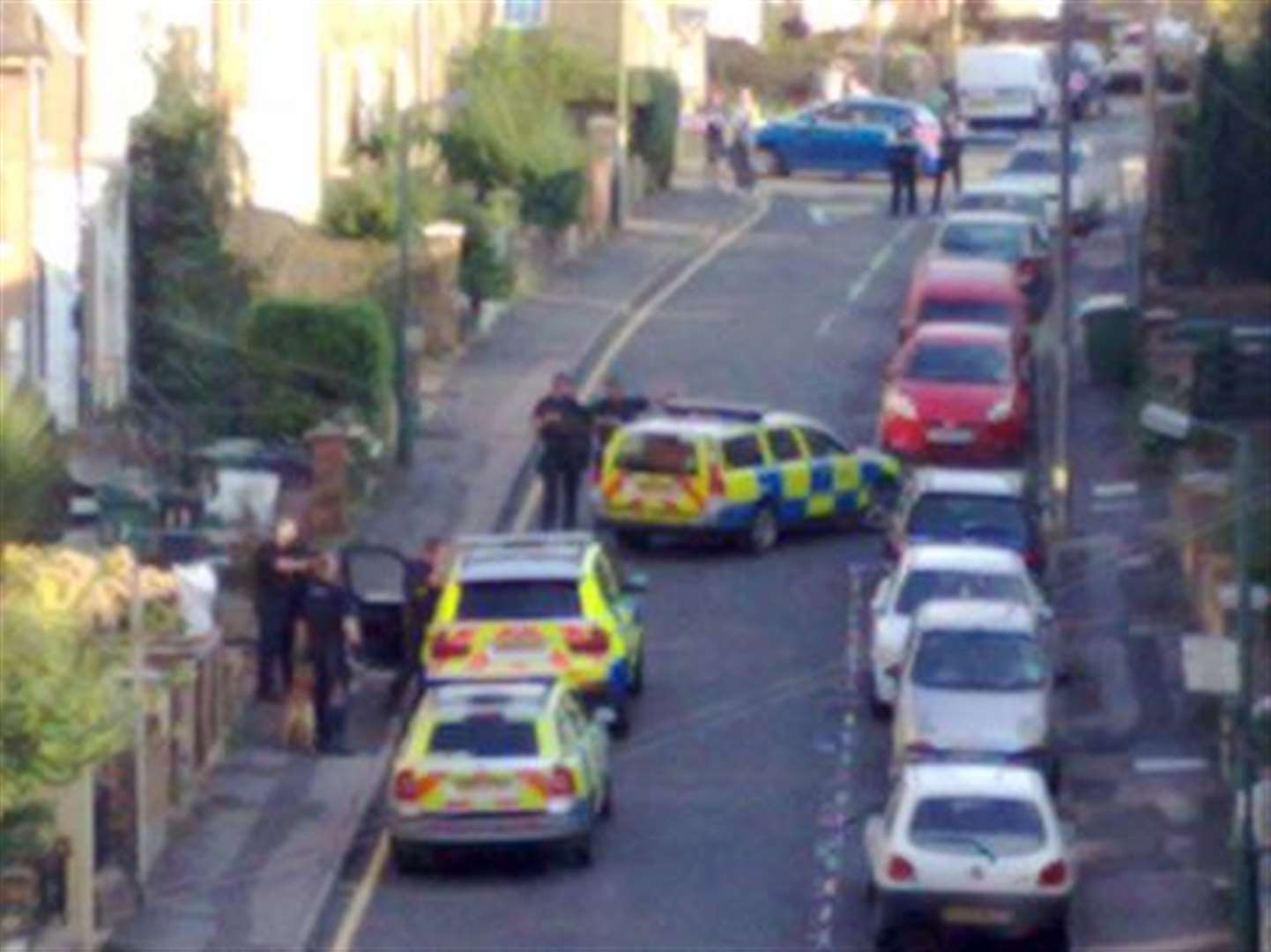 Armed police seal off road