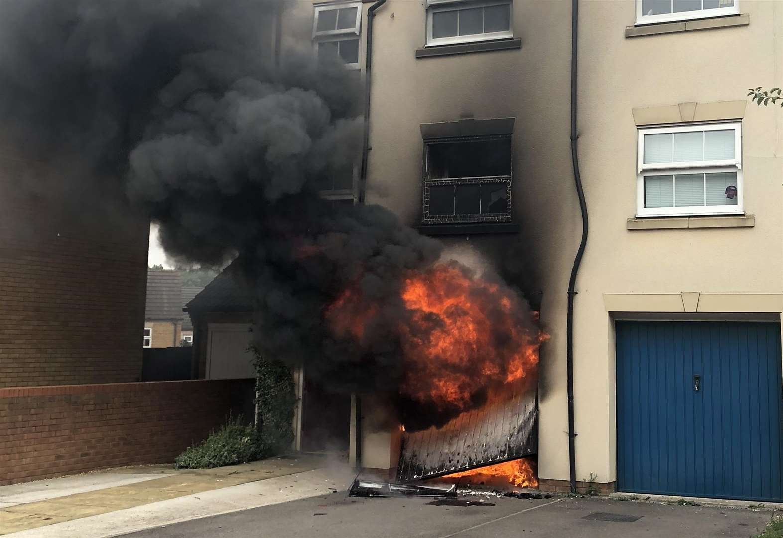 Garage flames spread to house
