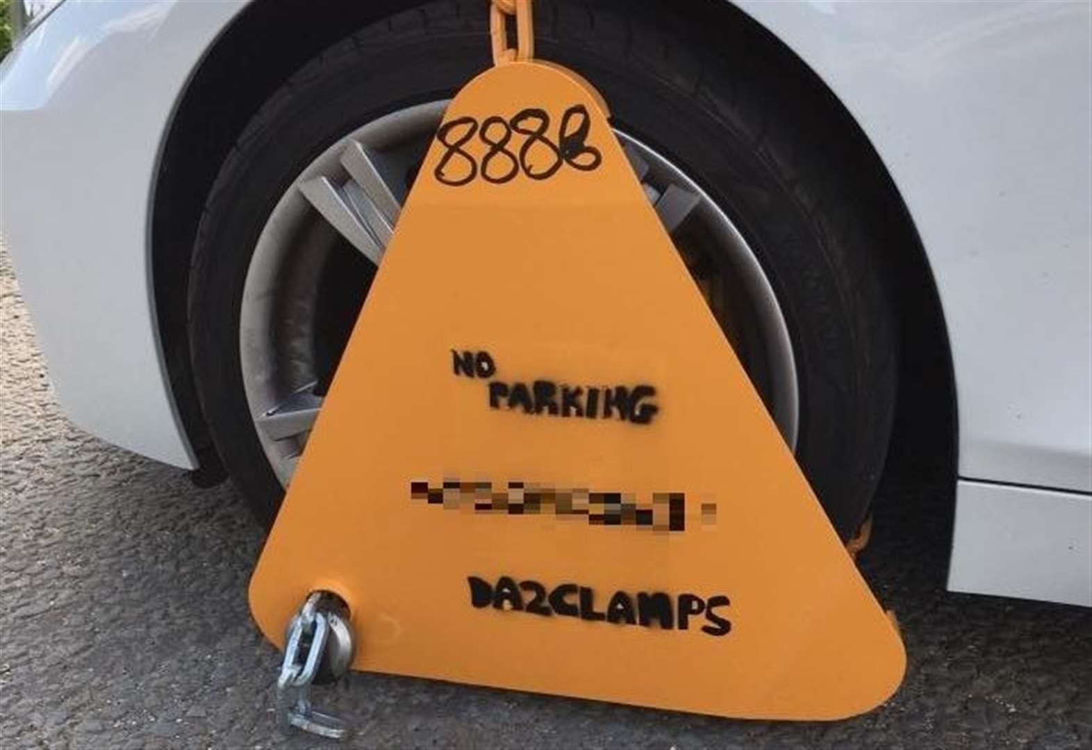 Car clamped by scammers