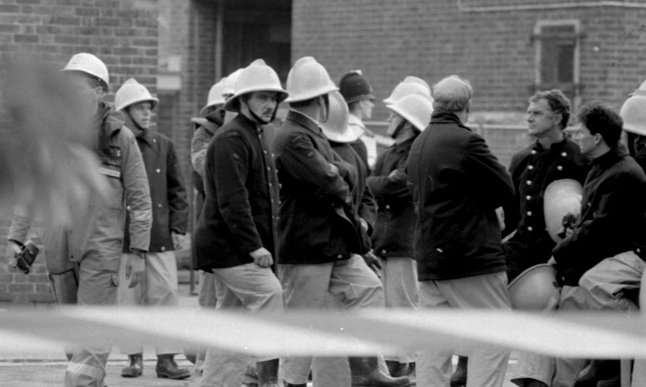Firefighters outside the barracks on the day of the bombing