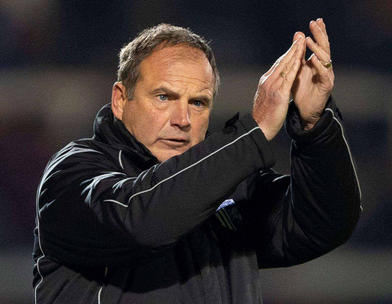Gillingham boss Steve Lovell claps the fans for making the journey north. Picture: Ady Kerry