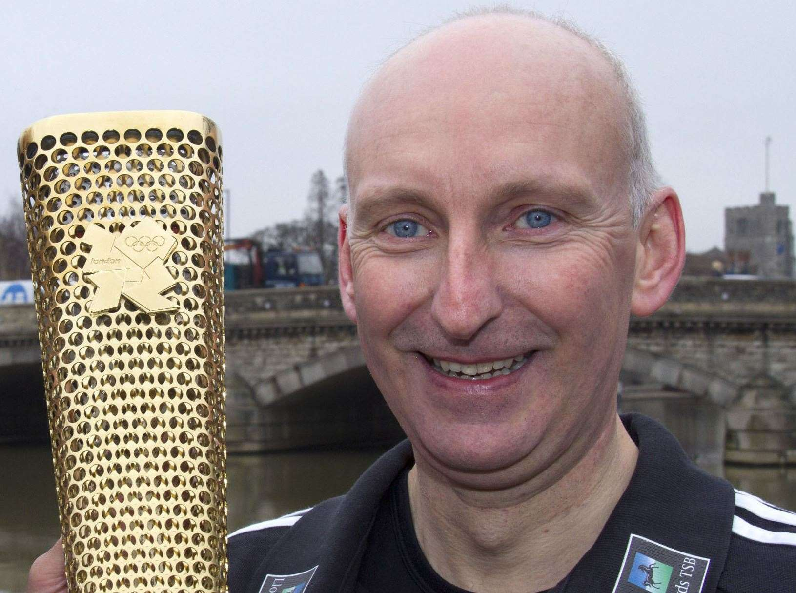 Det Sgt Melwyn Moore with the Olympic torch in 2012. Picture: Roger Vaughan